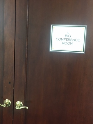 "Photo of classroom door with a sign on it reading ""Conference Room"""