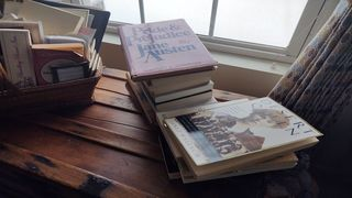 Books stacked up, waiting to be read