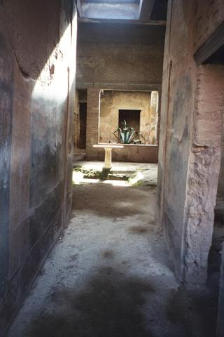 View of an ancient fountain in a courtyard in Pompeii.