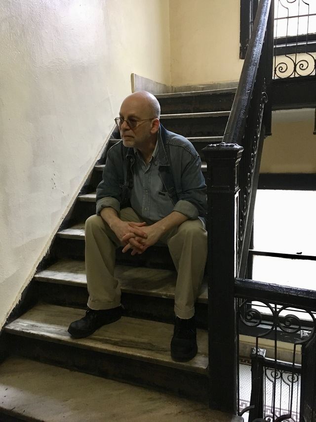 The author, sitting outside his old apartment on East 17th Street, in Flatbush.