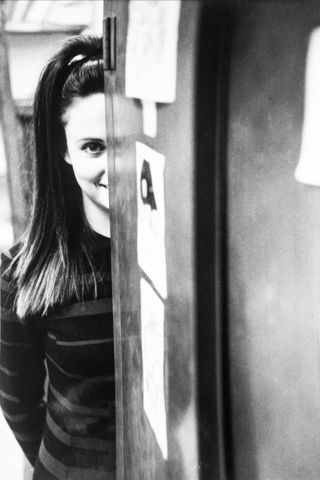 Image of Laurie attempting to hide from a camera long ago.